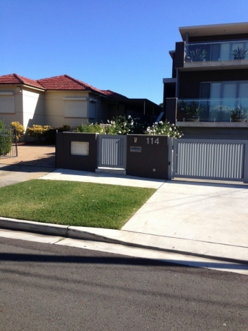 Automatic swinging driveway gates custom louvre design Sydney