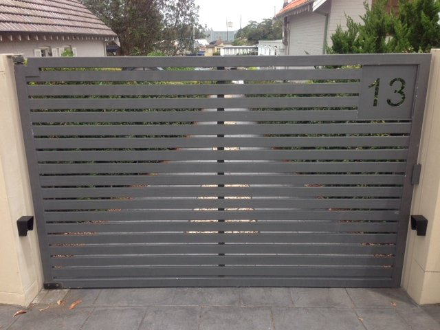 Automatic swinging driveway gates slats Sydney